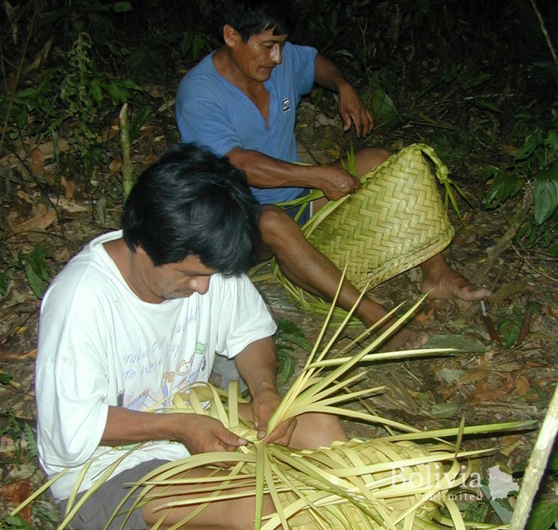 "Nativos Tacana Tejiendo - ""Some indigenous Tacana people building baskets out of palm leaves"""